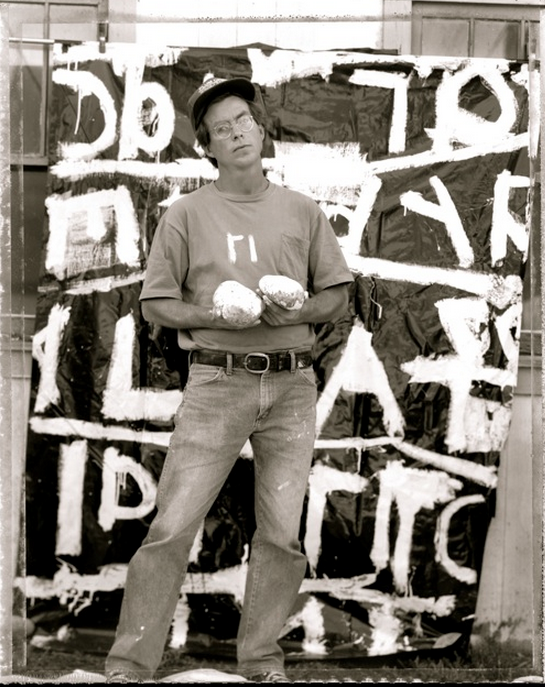 Jerry Inverson in front of Language Series painting